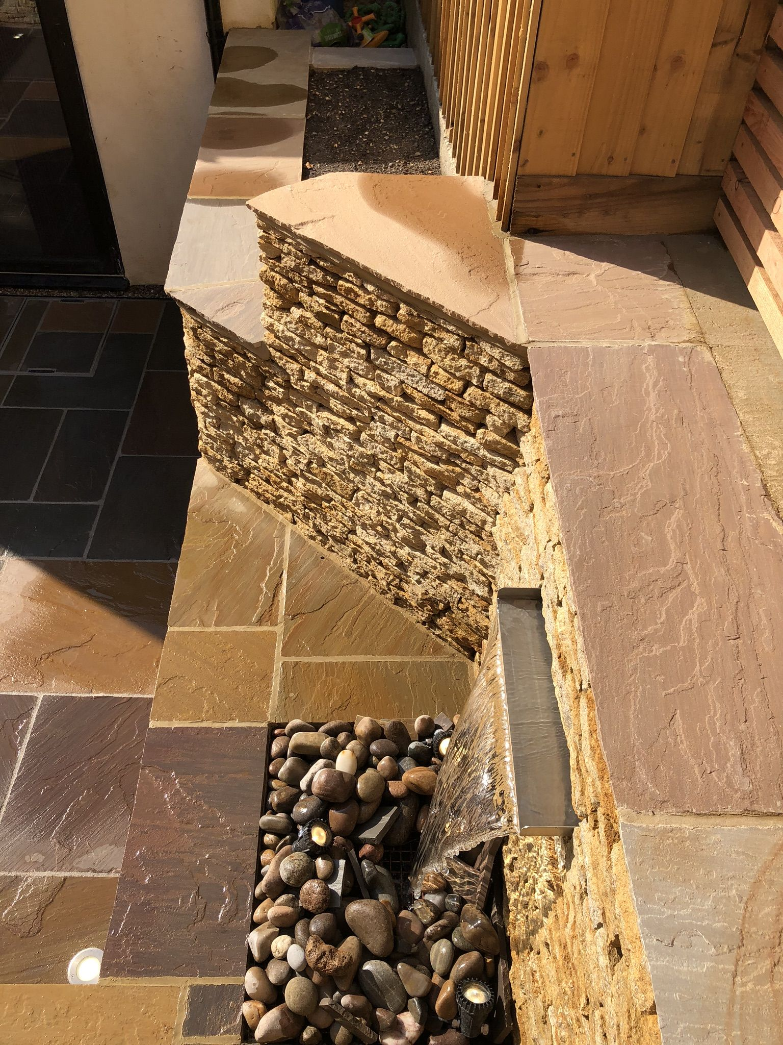 Stone walling and water feature.